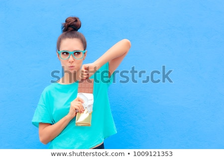 Young woman with a huge bar of chocolate Stock photo © photography33