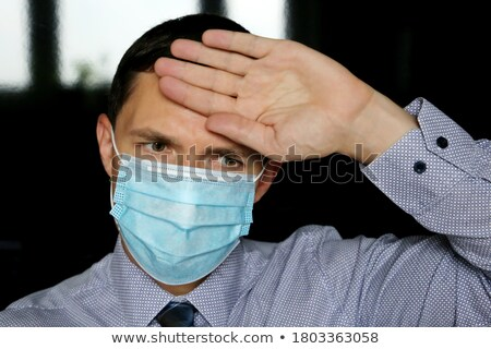 businessman with hands to forehead facing pressure stock photo © photography33