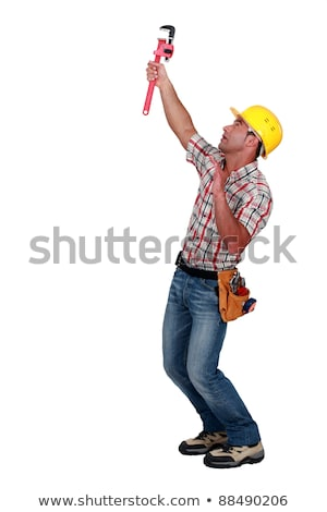 Tradesman using a pipe wrench to tighten an object Stock photo © photography33