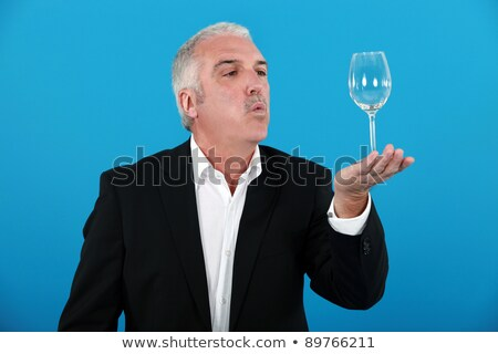 Man blowing a wine glass Stock photo © photography33