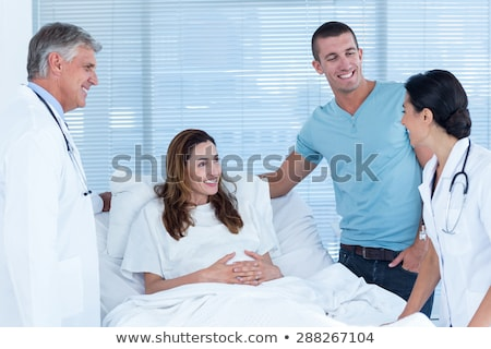 Attractive doctor attending a patient Stock photo © wavebreak_media