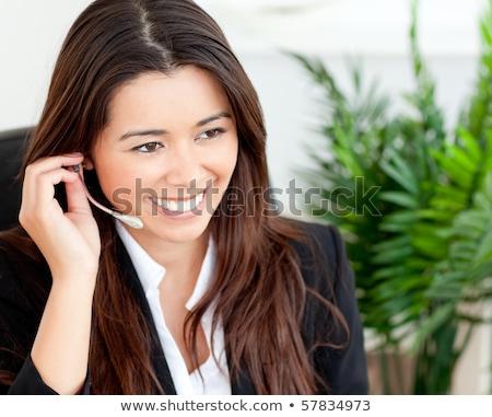 Radiant woman using a microphone Stock photo © wavebreak_media