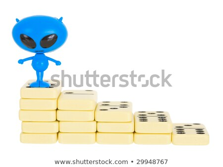 Blue toy alien on a heap from dominoes Stock photo © pzaxe