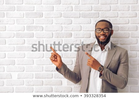 Portrait of a smiling employee pointing against white background Stock photo © wavebreak_media