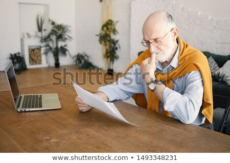 Frustrated businessman biting his laptop Stock photo © smithore