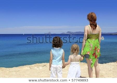 two sister girls summer Cala Saona Formentera Stock photo © lunamarina