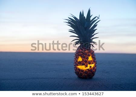 Halloween on Beach. Pinapple jack o lantern stock photo © KonArt