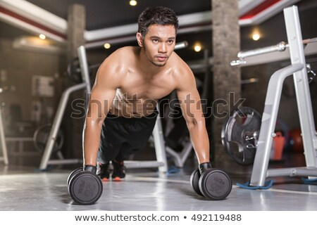 Asian man exercising with kettlebell Stock photo © sumners