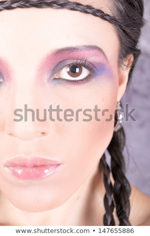 Hippie girl with purple makeup and breaded hair on forehead Stock photo © pxhidalgo