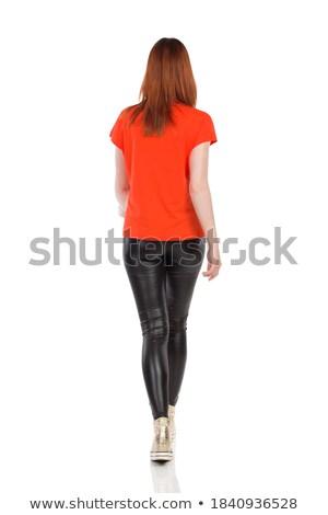 Achteraanzicht meisje strak leder pants geïsoleerd Stockfoto © Elisanth