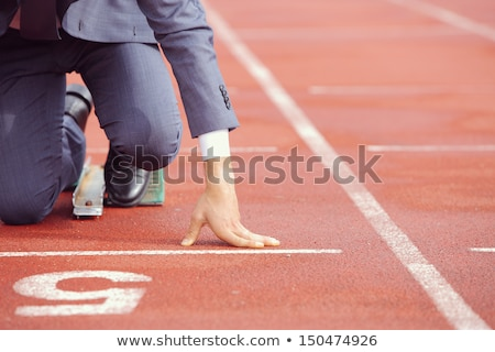 Businessmen lined up on track starting line  Stock photo © Kirill_M