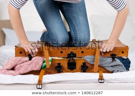 ストックフォト: スーツケース · 若い女性 · ジャンプ · 孤立した