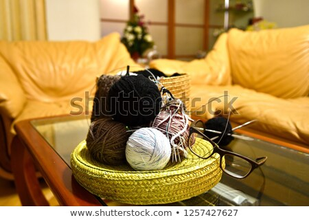 colorful balls of yarn on the gray armchair stock photo © dashapetrenko