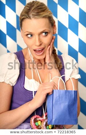 Oktoberfest, blond young woman holding gingerbread heart Stock photo © runzelkorn