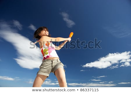 teenage girl playing baseball on beach stock photo © monkey_business