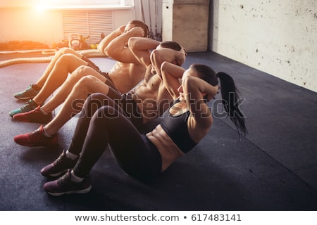 man working abs in gym Stock photo © Hofmeester