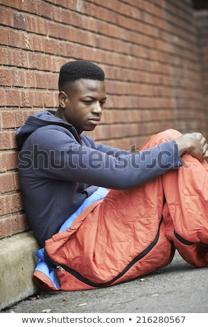 Vulnerable Teenage Boy Sleeping On The Street Stock photo © HighwayStarz