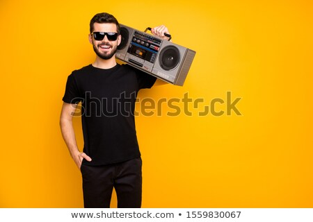 Young fashion man holding his lover by the shoulder Stock photo © feedough