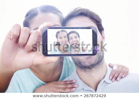 молодые · черную · женщину · телефон · улыбаясь · черный - Сток-фото © wavebreak_media