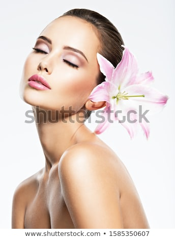 Portrait of a cute woman with flower and closed eyes Stock photo © deandrobot