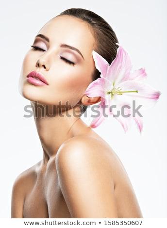 Portré aranyos nő virág csukott szemmel kezek Stock fotó © deandrobot