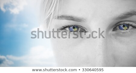 composite image of pretty blonde applying contact lens stock photo © wavebreak_media