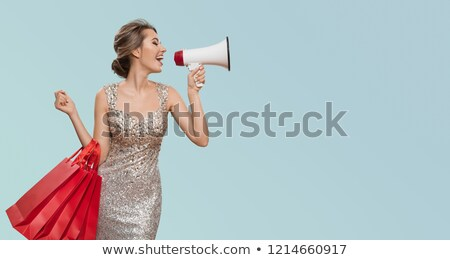 Happy charming woman posing in dress stock photo © deandrobot