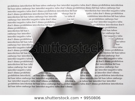Stock photo: the sheet of paper with printing words and the cut hole against the black background