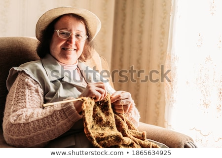 Elderly woman concentrating on her knitting Stock photo © ozgur