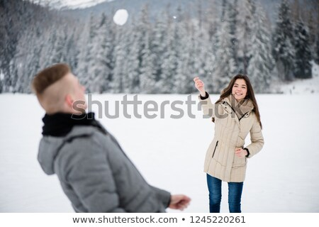 Kadın oynama erkek arkadaş genç kadın kış Stok fotoğraf © deandrobot