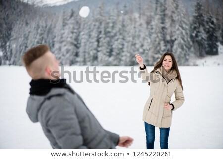 Alegre mulher jogar namorado mulher jovem inverno Foto stock © deandrobot