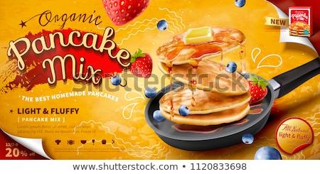Fried pancake with strawberry and maple syrup Stock photo © rafalstachura