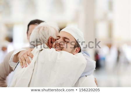 Stock photo: Muslim Arabic brothers meeting together with father