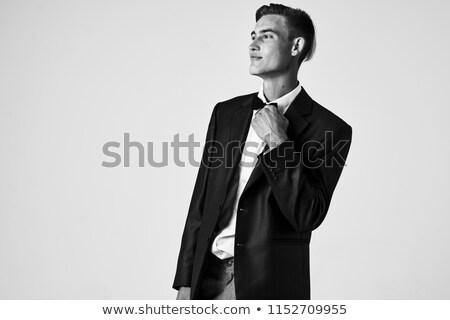 Retrato bonito jovem empresário preto casaco Foto stock © deandrobot