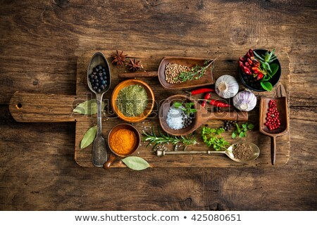 culinary background with empty cutting board and spices on wooden table Stock photo © yelenayemchuk