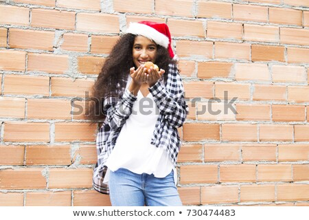 afroamerican woman smiling with a Santa's hat Stock photo © Giulio_Fornasar