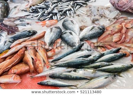 Colorful choice of fish at a market  Stock photo © elxeneize