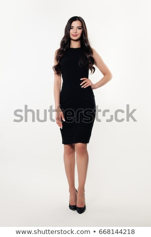érzéki · barna · hajú · fekete · ruha · néz · kamera · közelkép - stock fotó © deandrobot