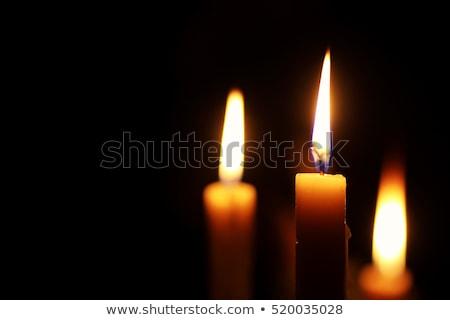 Burning candle in church Stock photo © kb-photodesign