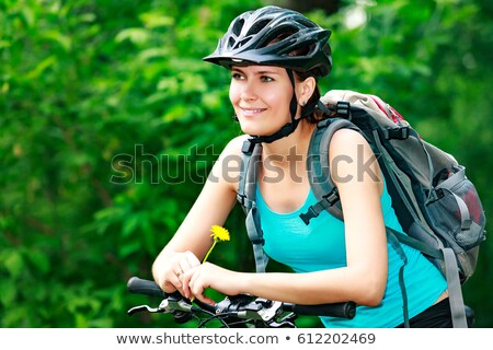 Woman biker holds a yellow flower Stock photo © Nobilior