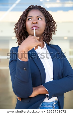 Young pretty businesswoman looking up with hands crossed  Stock photo © gravityimaging