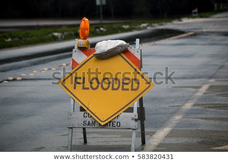 road closed traffic sign on a flooded road stock photo © jaykayl