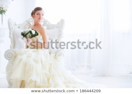 bride with a bouquet posing at the camera stock photo © tekso