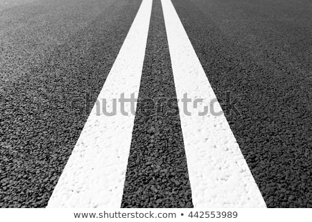 asphalt road with marking lines white stripes two solid lines stock photo © andreonegin
