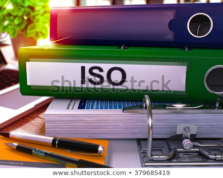 green ring binder with inscription iso stock photo © tashatuvango