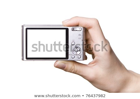 Man by window with digital camera Stock photo © IS2