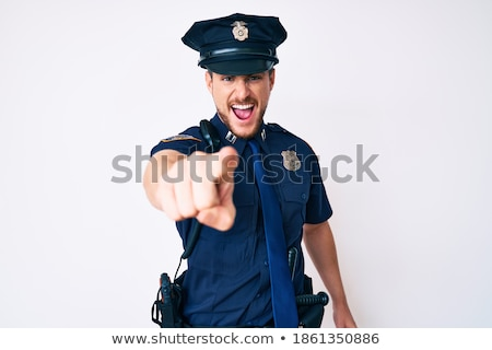 серьезный кавказский полицейский указывая молодые равномерный Сток-фото © RAStudio
