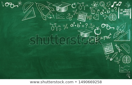 startup concept green chalkboard with doodle icons stock photo © tashatuvango