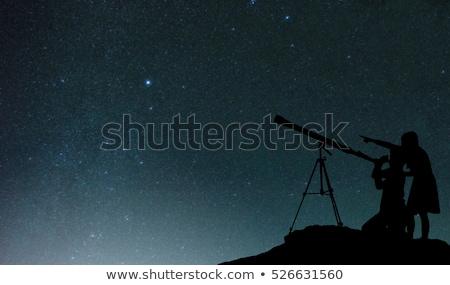 телескопом силуэта съемки звезды иллюстрация Сток-фото © adrenalina