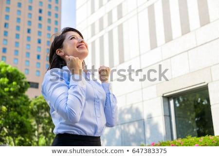 Boldog fiatal nő ököl pumpa kézmozdulat kifejezések Stock fotó © dolgachov